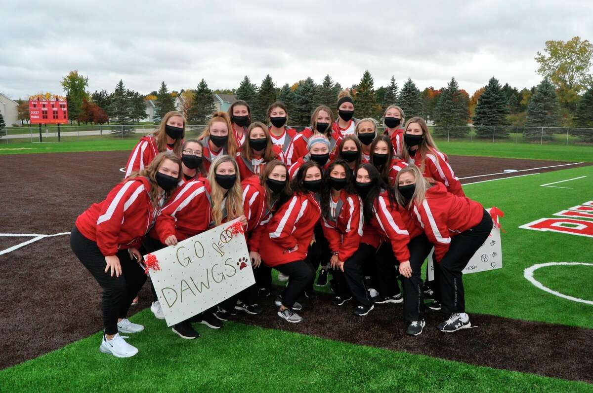 Ferris softball players gather to celebrate the renovation of their new field. (Ferris State courtesy photo)