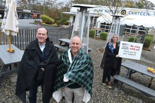 From left, Gerry Barker, Rob Kauffman, co-owner of The Stand, and server Keya Recchia are photographed in the outdoor dining area of The Stand in Branford on October 16, 2020, to promote the Bring Your Own Blanket campaign for outdoor dining in the colder months ahead.