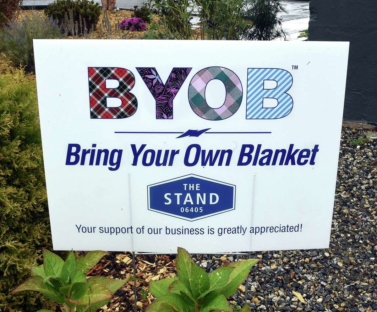 A Bring Your Own Blanket sign displayed in front of of The Stand in Branford.