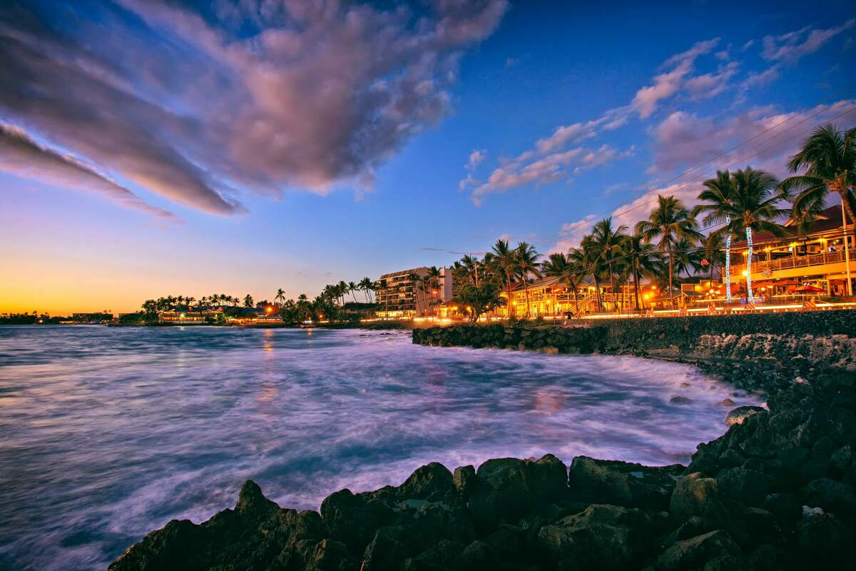 The sun sets along Alii Drive on the beach town of Kailua Kona on the Big Island of Hawaii.