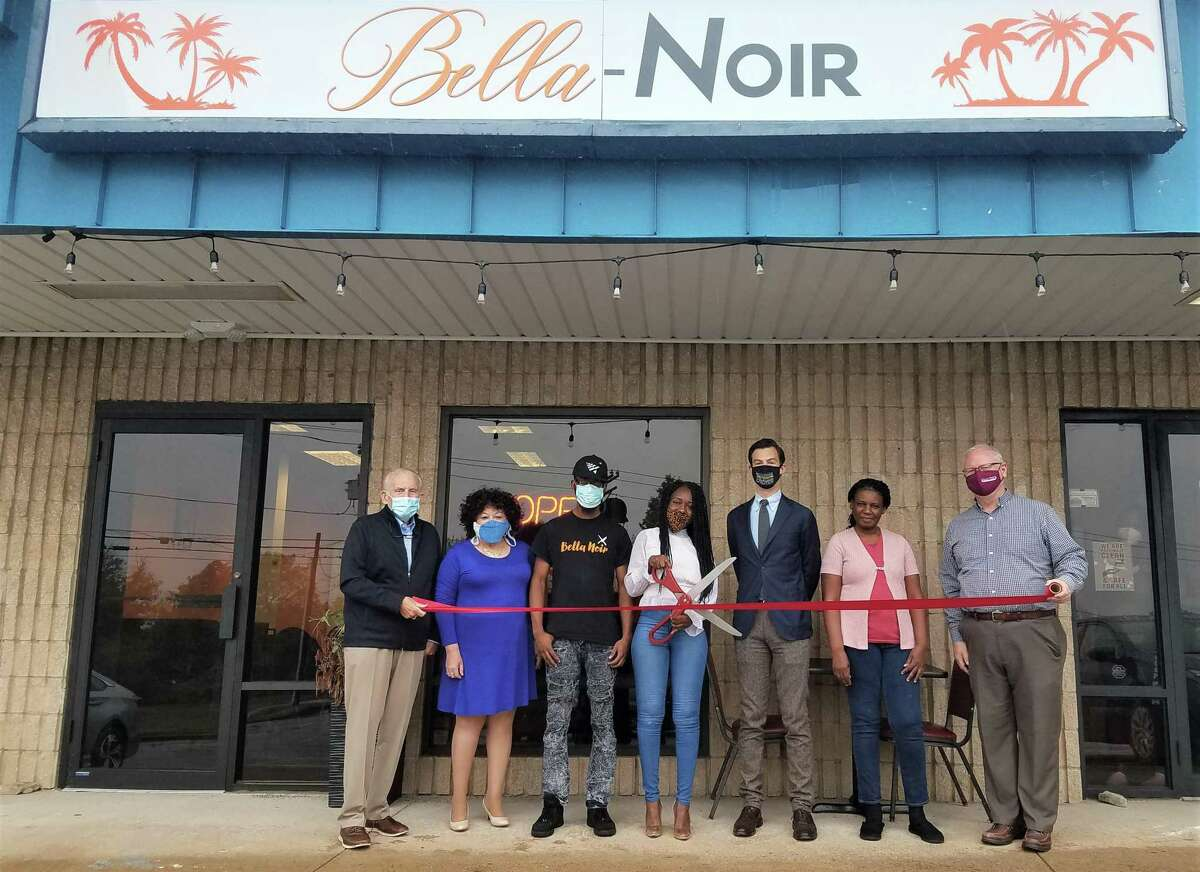 Bella-Noir Caribbean Restaurant held a grand opening Oct. 13. From left are Middlesex Chamber President Larry McHugh, Central Business Bureau Chairwomen Pamela Steele, owner's brother Roberson Pierre Louis, owner Magdala Pierre Louis, Mayor Ben Florsheim, owner's mother AnneMarie Mesidor, and Chamber Chairman Tom Byrne.