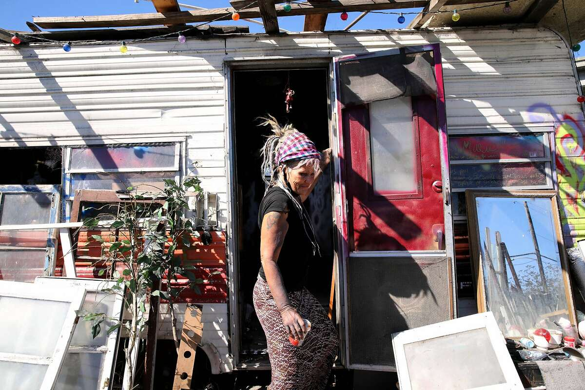 """Wood Street resident Mavin Carter-Griffin, 55, leaves her camper. """"They're just redlining homeless people,"""" she says of the proposal."""