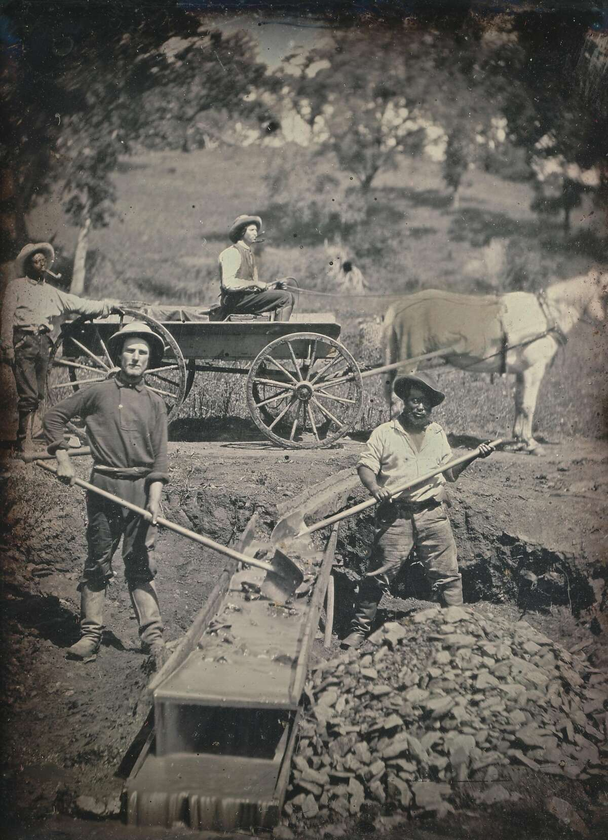 African American and white miners during the Gold Rush era in 1852. The photograph was taken near Spanish Flat (Napa County).