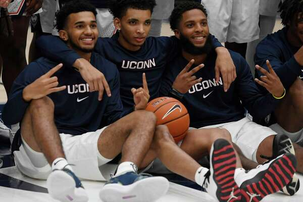 UConn's Jalen Gaffney, left, James Bouknight, center, and R.J. Cole, right, pose for a photo during last year's First Night celebration. Bouknight is the Huskies' unquestioned top dog, and both Gaffney and Cole have the potential be the team's No. 2 scorer.