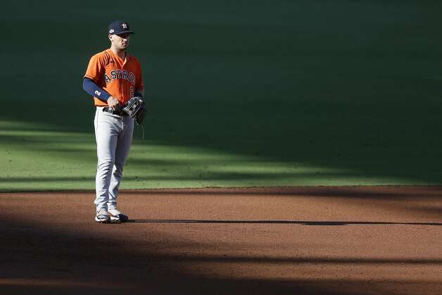 Houston Astros Alex Bregman stands in a strip of sunlight stretching across the field during Game 6 of the American League Championship Series against the Tampa Bay Rays at Petco Park Friday, Oct. 16, 2020, in San Diego. Photo: Karen Warren/Staff Photographer / © 2020 Houston Chronicle
