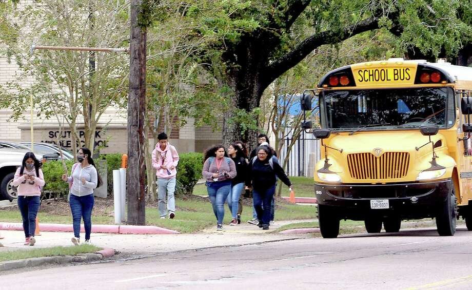 A bus drops off students outside the former South Park Middle School on the first day of BISD's second phase of reopening schools for in-person learning. Pre-kindergarten, kindergarten and 6th grades returned Monday. Photo taken Monday, September 28, 2020 Kim Brent/The Enterprise Photo: Kim Brent / The Enterprise / BEN