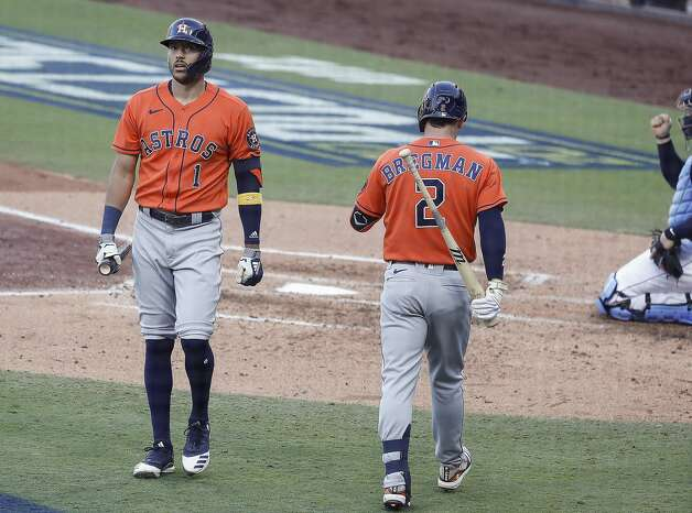 Houston Astros Carlos Correa (1) walks past Alex Bregman (2) after striking out during the fourth inning of Game 6 of the American League Championship Series against the Tampa Bay Rays at Petco Park Friday, Oct. 16, 2020, in San Diego. Photo: Karen Warren/Staff Photographer / © 2020 Houston Chronicle