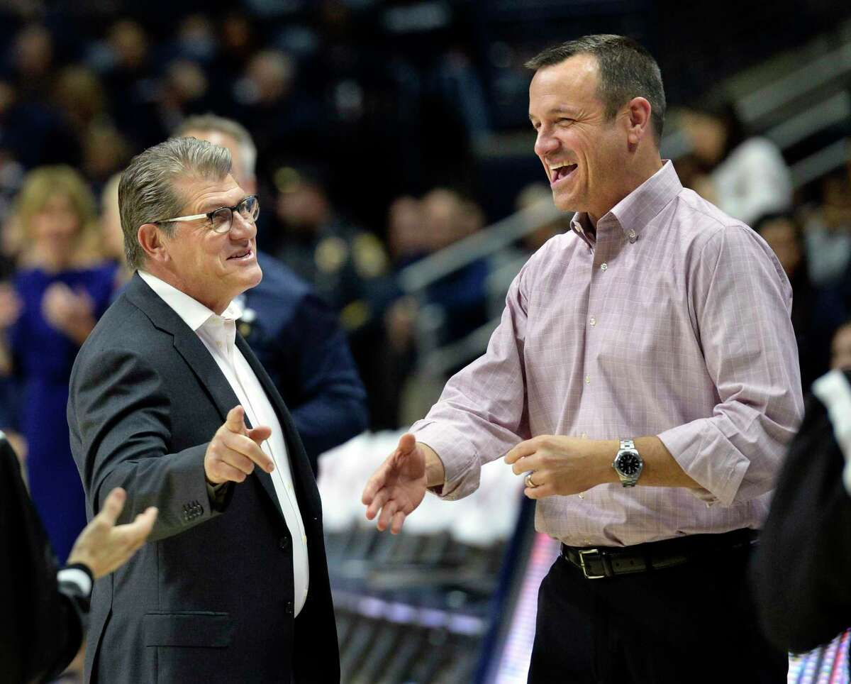 UConn coach Geno Auriemma, left, greets Louisville head coach Jeff Walz before a game in Storrs in 2018.