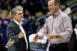 UConn head coach Geno Auriemma, left, greets Louisville head coach Jeff Walz before their NCAA women's basketball game on Feb. 12, 2018, in Storrs. UConn won, 69-58.