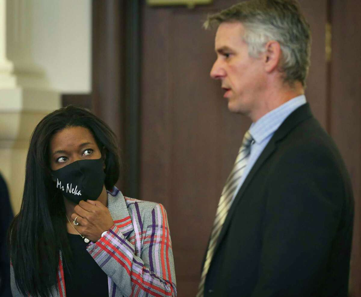 Neka Cleaver, left, listens to Christian Henricksen, chief of litigation at the Bexar County District Attorney's Office on Friday after D.A. Joe D. Gonzales announced the formation of a new division to review officer-involved shootings that result in injury or death.