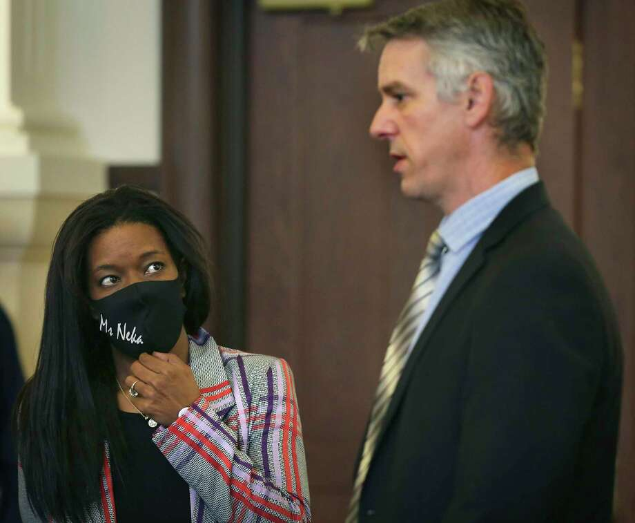 Neka Cleaver, left, listens to Christian Henricksen, chief of litigation at the Bexar County District Attorney's Office on Friday after D.A. Joe D. Gonzales announced the formation of a new division to review officer-involved shootings that result in injury or death. Photo: Bob Owen /San Antonio Express-News / ©2020 San Antonio Express-News