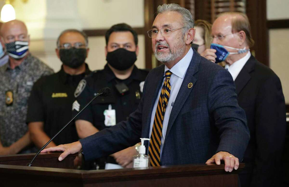 Bexar County District Attorney Joe D. Gonzales, supported by Bexar County Judge Nelson Wolff, right, announces on Friday the formation of a new division to investigate use of force by police that results in injury or death.