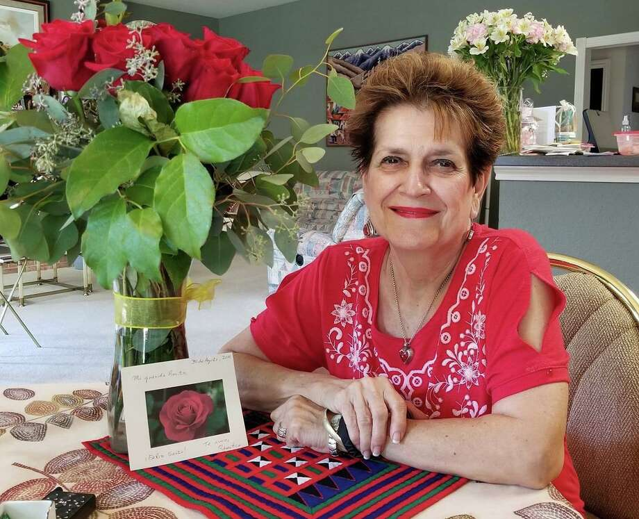 "Rosita Milk retired in 2006 after 23 years of working as a bilingual kindergarten teacher in the Edgewood Independent School District. A Peruvian immigrant, Milk was also president of La Hermandad del Señor de los Milagros and became known as the ""alfajores lady,"" for making and selling the Peruvian cookies. Photo: Courtesy Rosita Milk"