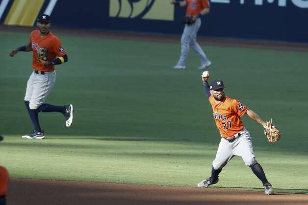 Houston Astros Jose Altuve (27) throws out Tampa Bay Rays Brandon Lowe during the fourth inning of Game 6 of the American League Championship Series at Petco Park Friday, Oct. 16, 2020, in San Diego. Photo: Karen Warren/Staff Photographer / © 2020 Houston Chronicle