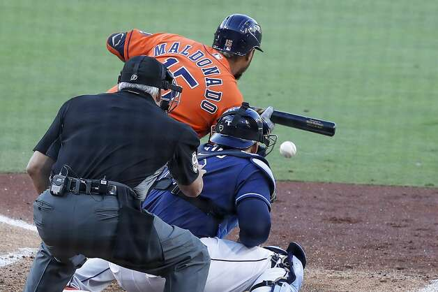 Houston Astros Martin Maldonado (15) lays down a sacrifice bunt in front of Tampa Bay Rays catcher Mike Zunino, moving Yuli Gurriel to 3rd and Aledmys Diaz to 2nd, during of Game 6 of the American League Championship Series at Petco Park Friday, Oct. 16, 2020, in San Diego. Photo: Karen Warren/Staff Photographer / © 2020 Houston Chronicle