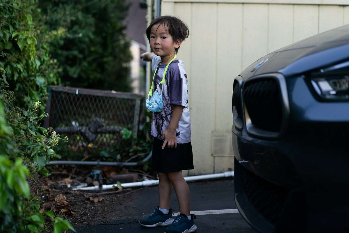 James Trinh, 5, stands in a parking lot and shows where he first saw Maki the Lemur on top of an irrigation cage before heading to the playground of the Hope Lutheran Playground on Friday, Oct. 16, 2020 in South San Francisco, Calif.