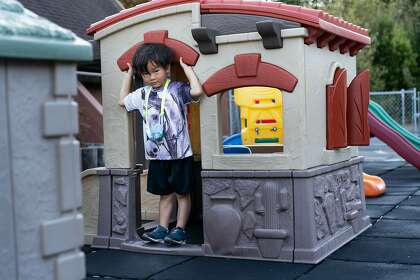 James Trinh, 5, shows how the maki Maki walked into this house before being caught on the playground at the Hope Lutheran Playground on Friday, October 16, 2020 in South San Francisco, California.