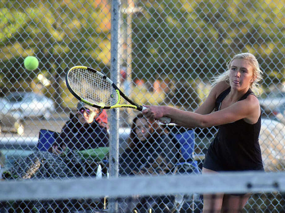 Edwardsville's Emma Herman smashes a return shot during her doubles match in the quarterfinals of the Class 2A Edwardsville Sectional on Friday. Photo: Matt Kamp|The Intelligencer