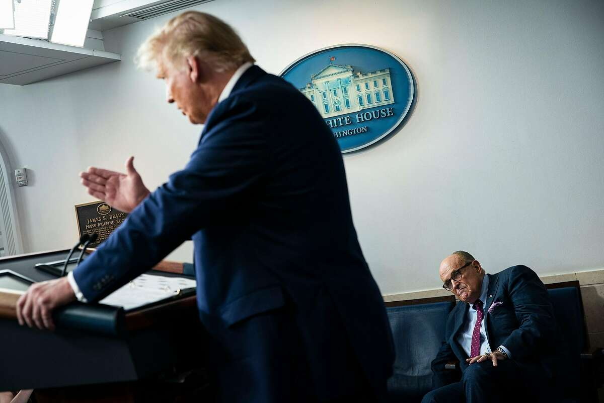 President Trump speaks during a September news briefing as personal lawyer Rudy Giuliani listens.
