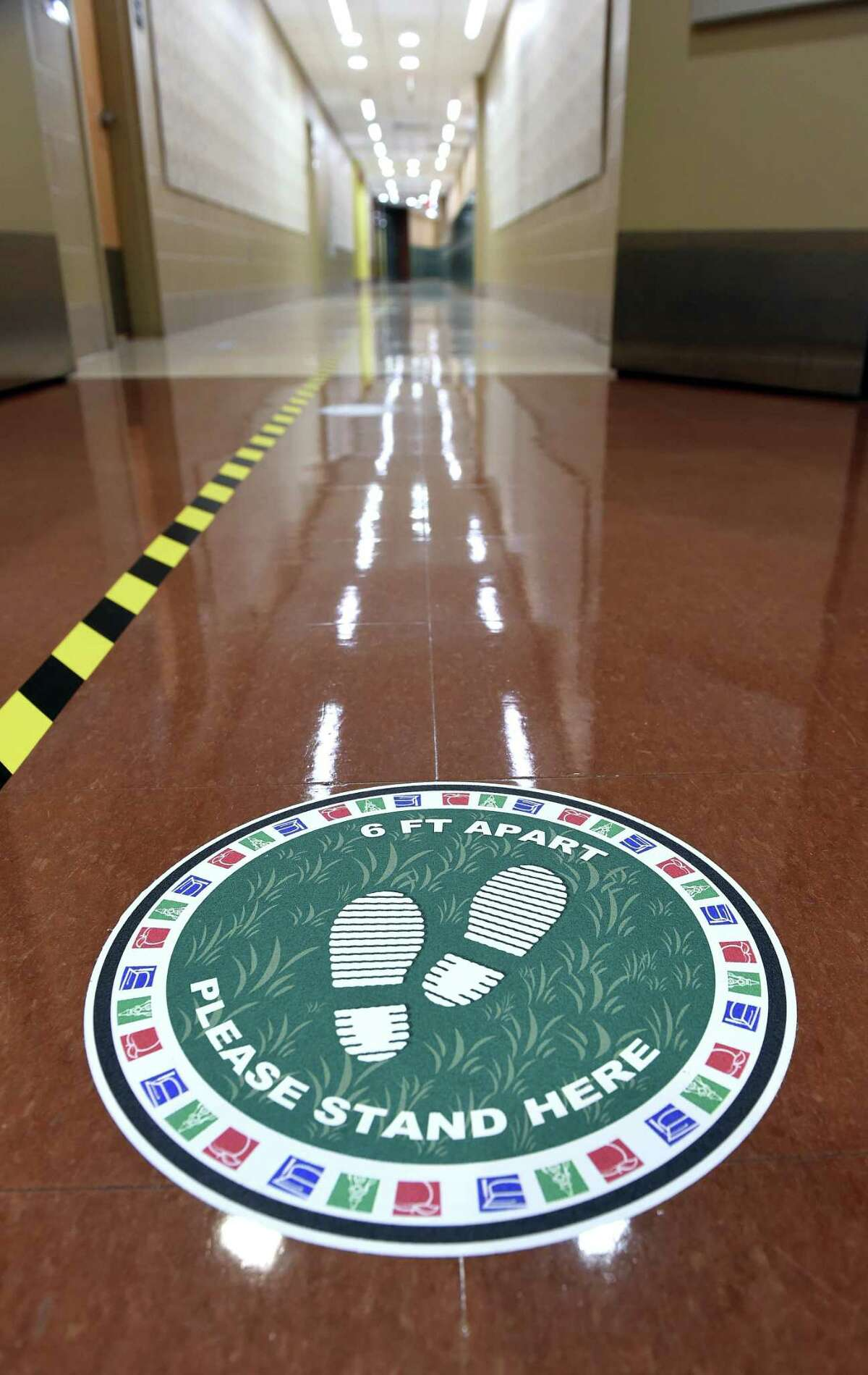 Social distancing reminders are affixed to the floors at Bishop Woods School in New Haven.