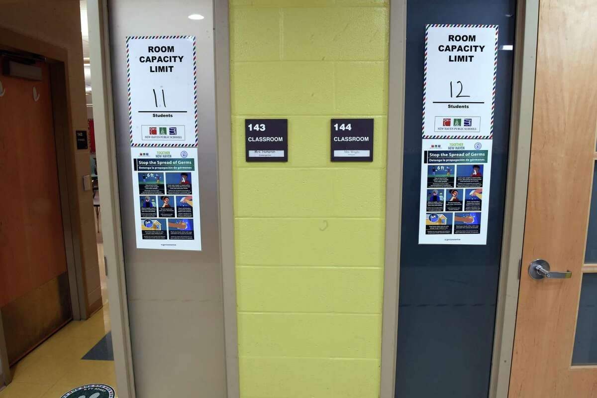 Classrooms at Bishop Woods School in New Haven have capacity limits posted at the entrance on October 16, 2020.