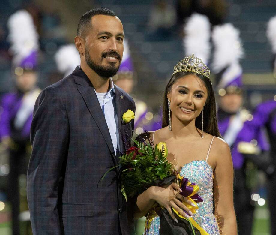 Midland High's Ashley Zarate, escorted by her father, Streven Zarate, is crowned 2020 Homecoming Queen 10/16/2020 at Grande Communications Stadium. Tim Fischer/Reporter-Telegram Photo: Tim Fischer, Midland Reporter-Telegram