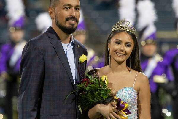 Midland High's Ashley Zarate, escorted by her father, Streven Zarate, is crowned 2020 Homecoming Queen 10/16/2020 at Grande Communications Stadium. Tim Fischer/Reporter-Telegram