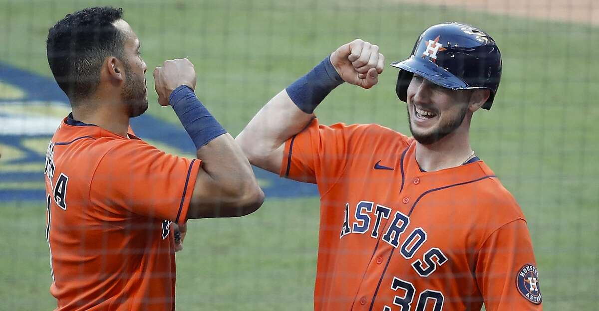 Houston Astros Kyle Tucker celebrates with Carlos Correa (1) after hitting a solo home run against the Tampa Bay Rays during the sixth inning of Game 6 of the American League Championship Series at Petco Park Friday, Oct. 16, 2020, in San Diego.