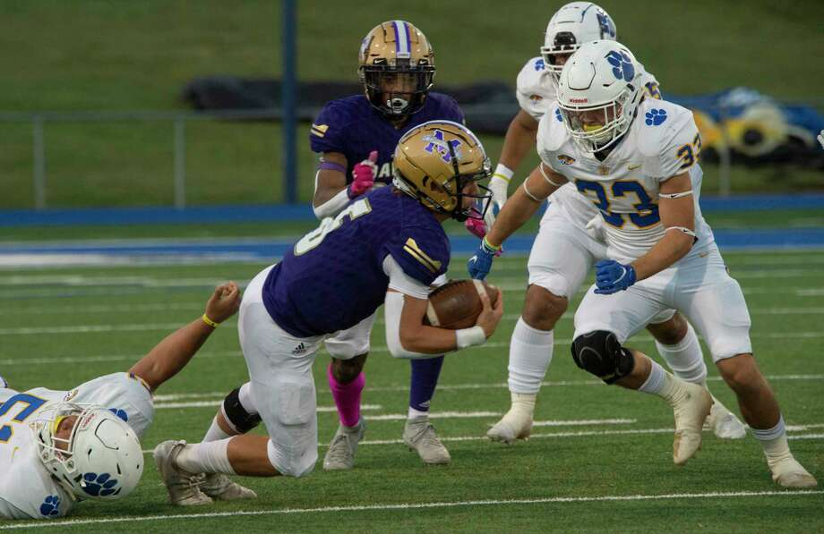 Midland High's Landry Walls gets tripped up by Frenship's Trace Buchanan as David KP closes in to bring him down 10/16/2020 at Grande Communications Stadium. Tim Fischer/Reporter-Telegram Photo: Tim Fischer, Midland Reporter-Telegram