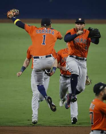 Houston Astros Carlos Correa (1) and George Springer (4) celebrate the Astros 7-4 win over the Tampa Bay Rays in Game 6 of the American League Championship Series at Petco Park Friday, Oct. 16, 2020, in San Diego. The Astros tied the best-of-seven series, forcing a Game 7. Photo: Karen Warren/Staff Photographer / © 2020 Houston Chronicle