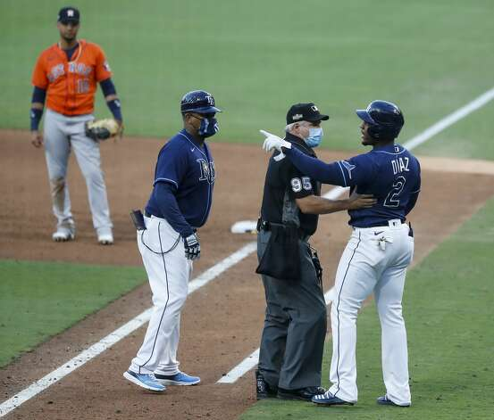 Tampa Bay Rays Yandy Diaz (2) points to Houston Astros Framber Valdez after he drew a walk during the sixth inning of Game 6 of the American League Championship Series at Petco Park Friday, Oct. 16, 2020, in San Diego. Photo: Karen Warren/Staff Photographer / © 2020 Houston Chronicle