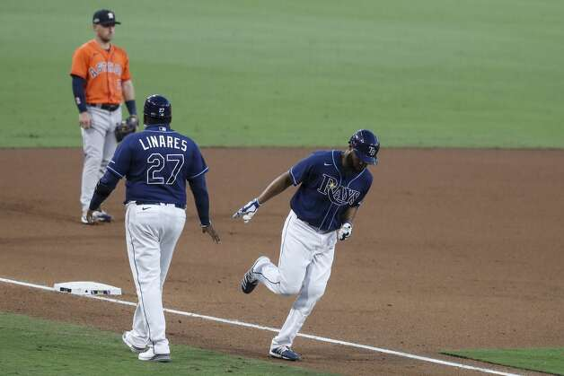 Tampa Bay Rays Manuel Margot rounds third after hitting a solo home run off Houston Astros reliever Andre Scrubb of Game 6 of the American League Championship Series at Petco Park Friday, Oct. 16, 2020, in San Diego. Photo: Karen Warren/Staff Photographer / © 2020 Houston Chronicle