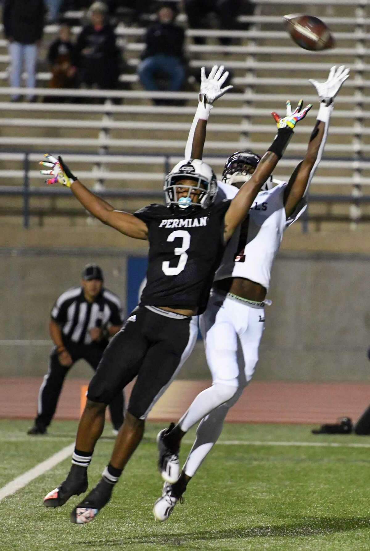 Lee's Tre Hubert (1) attempts to intercept as Permian's D'Shybreon Stephens-Deary (3) tries to catch the pass Friday, Oct. 16, 2020 at Ratliff Stadium. Jacy Lewis/Reporter-Telegram