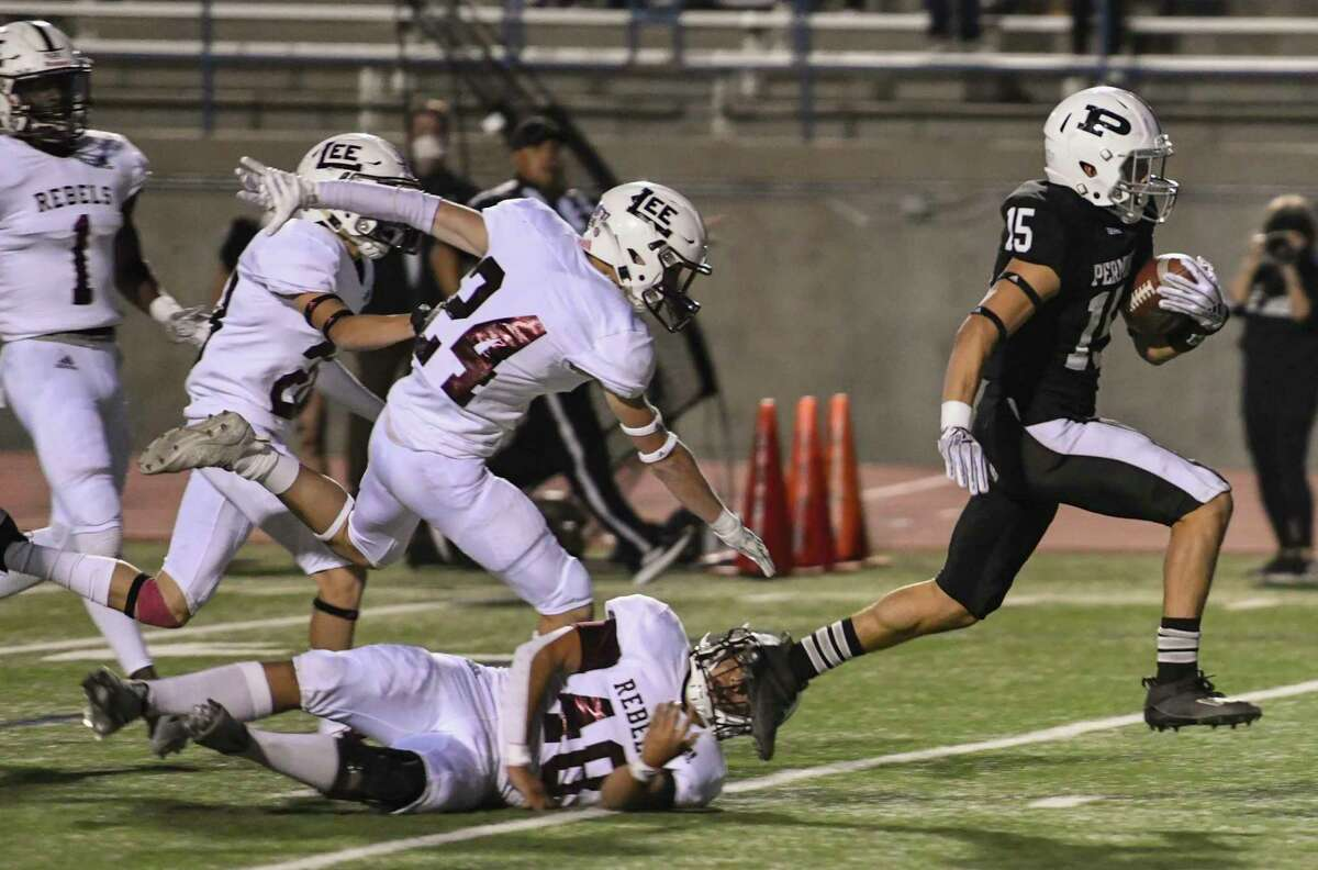 Permian's Lucas Salazar (15) scores a touchdown as Lee defenders Abraham Davalos (48), Finley Higgins (24), Tristen Rice (28) and Tre Hubert (1) fall behind him Friday, Oct. 16, 2020 at Ratliff Stadium. Jacy Lewis/Reporter-Telegram