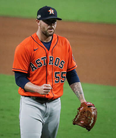 Houston Astros Ryan Pressly pumps his fist after closing out Game 6 of the American League Championship Series against the Tampa Bay Rays at Petco Park Friday, Oct. 16, 2020, in San Diego. The Astros won 7-4 to even the best-of-seven series, forcing a Game 7. Photo: Karen Warren/Staff Photographer / © 2020 Houston Chronicle