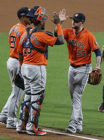 Houston Astros Michael Brantley (23), Martin Maldonado (15) and Ryan Pressly (55) celebrate the Astros win over the Tampa Bay Rays in Game 6 of the American League Championship Series against the Tampa Bay Rays at Petco Park Friday, Oct. 16, 2020, in San Diego. The Astros won 7-4 to even the best-of-seven series, forcing a Game 7. Photo: Karen Warren/Staff Photographer / © 2020 Houston Chronicle