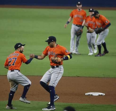 Houston Astros Jose Altuve (27) and Carlos Correa (1) celebrate the Astros win over the Tampa Bay Rays in Game 6 of the American League Championship Series against the Tampa Bay Rays at Petco Park Friday, Oct. 16, 2020, in San Diego. The Astros won 7-4 to even the best-of-seven series, forcing a Game 7. Photo: Karen Warren/Staff Photographer / © 2020 Houston Chronicle