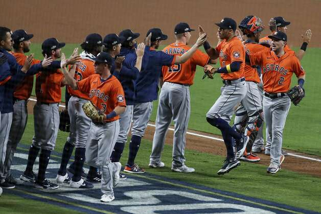 The Houston Astros celebrate their 7-4 win over the Tampa Bay Rays in Game 6 of the American League Championship Series against the Tampa Bay Rays at Petco Park Friday, Oct. 16, 2020, in San Diego. The Astros evened the best-of-seven series, forcing a Game 7. Photo: Karen Warren/Staff Photographer / © 2020 Houston Chronicle