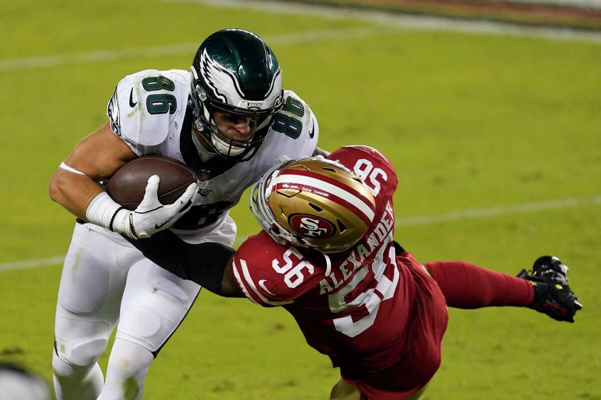 Philadelphia Eagles tight end Zach Ertz (86) runs against San Francisco 49ers outside linebacker Kwon Alexander (56) during the second half of the Eagles' win in Santa Clara, Calif., Sunday, Oct. 4, 2020. An average of 15.6 million viewers watched the game on NBC's Sunday Night Football.
