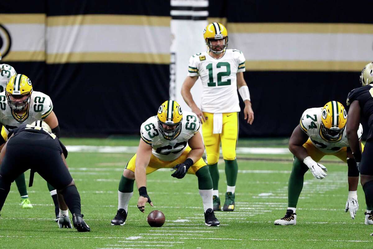 Green Bay Packers center Corey Linsley (63) and quarterback Aaron Rodgers (12) during the Packers' win against the New Orleans Saints on Sunday, Sept. 27, 2020, in New Orleans. An average of 18.4 million viewers watched the game on NBC's Sunday Night Football.