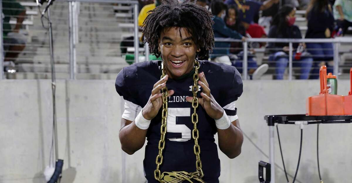 Spring quarterback Bishop Davenport (5) dons a golden mascot chain on the sidelines during the second half of a high school football game against the Dekaney Wildcats Friday, Oct. 9, 2020 at Planet Ford Stadium in Spring, TX.