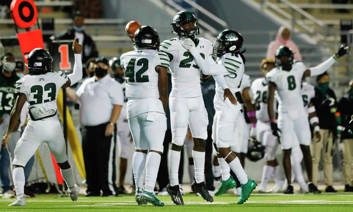 Fort Bend Hightower cornerback Julian Payne (23) is mobbed by teammates after intercepting a pass from The Woodlands quarterback Connor Dechiro during the second quarter of a non-district high school football game at Woodforest Bank Stadium, Friday, Oct. 156 2020, in Shenandoah.