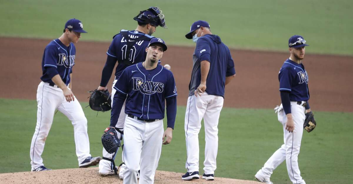 Tampa Bay Rays Blake Snell walks off the mound after being lifted fro the game by manager Kevin Cash during the fifth inning of Game 6 of the American League Championship Series against the Houston Astros at Petco Park Friday, Oct. 16, 2020, in San Diego.