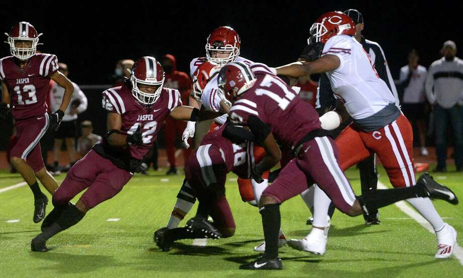 Jasper's defense, including Kaleb Sells, move in to stop Carthage Friday night at Bulldog Stadium. Photo taken Friday, October 16, 2020 Kim Brent/The Enterprise Photo: Kim Brent / The Enterprise / BEN