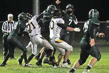 The Bad Axe varsity football team claimed at least a share of the Greater Thumb Conference West title on Friday night after beating host Laker, 27-6. The Hatchets improved to 4-1 on the season.