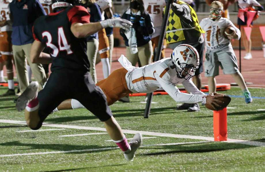 Madison quarterback Royal Kyle (03) dives in for his second touchdown in the first half against Churchill's Jack Tillman (34) during their football game at Heroes Stadium on Friday, Oct. 16, 2020. Photo: Kin Man Hui, San Antonio Express-News / Staff Photographer / **MANDATORY CREDIT FOR PHOTOGRAPHER AND SAN ANTONIO EXPRESS-NEWS/NO SALES/MAGS OUT/ TV OUT