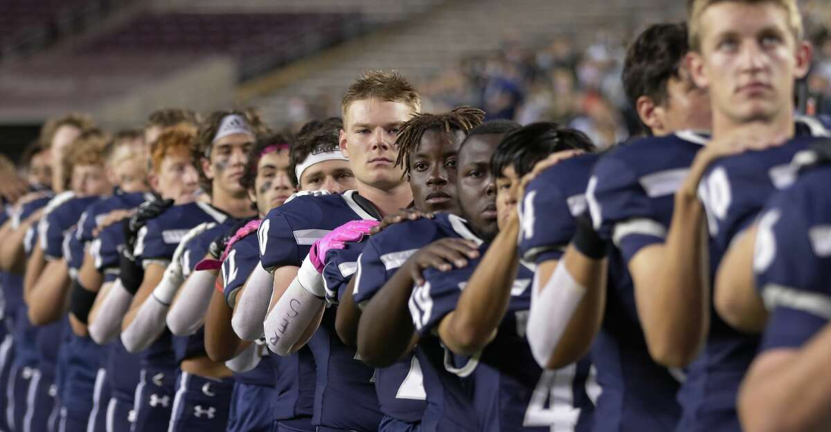 Tomball Memorial players stand for the National Anthem before the start of a high school football game against Tomball played at Kyle Field Friday, Oct. 16, 2020 in College Station, TX.