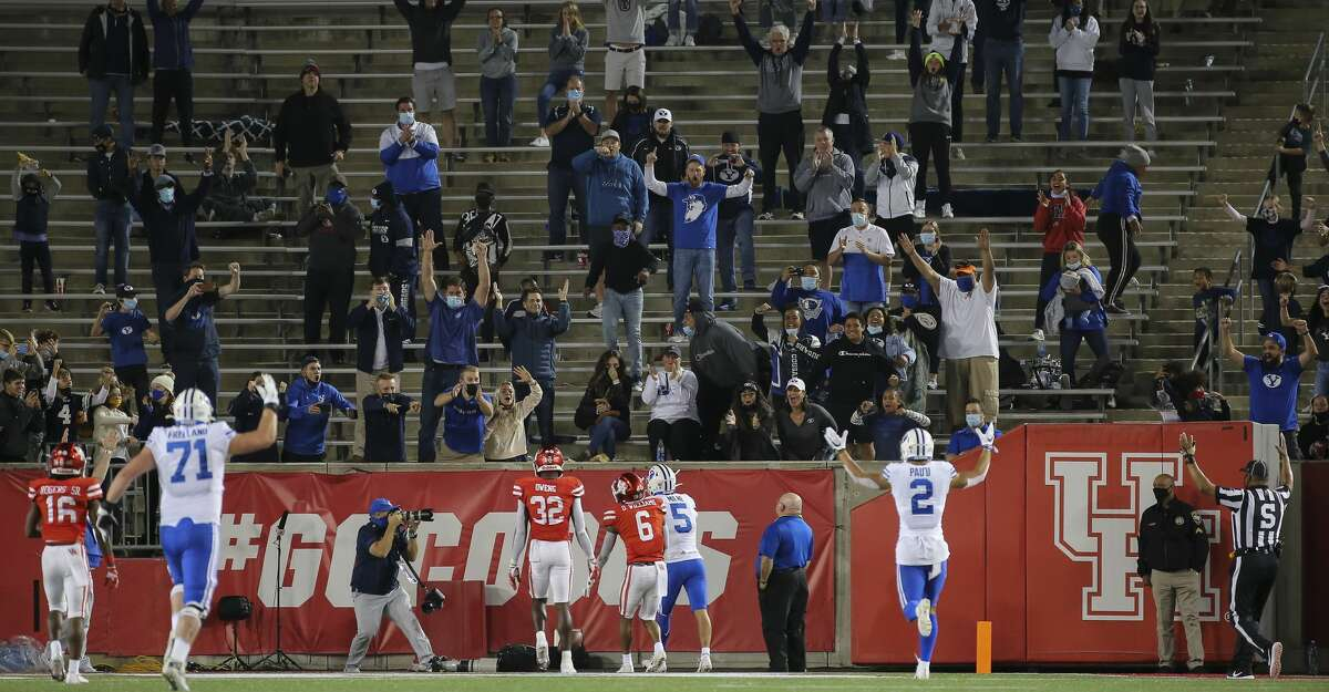 Brigham Young Cougars players and fans celebrate wide receiver Dax Milne's (5) touchdown during the fourth quarter against the Houston Cougars Saturday, Oct. 17, 2020, at TDECU Stadium in Houston.