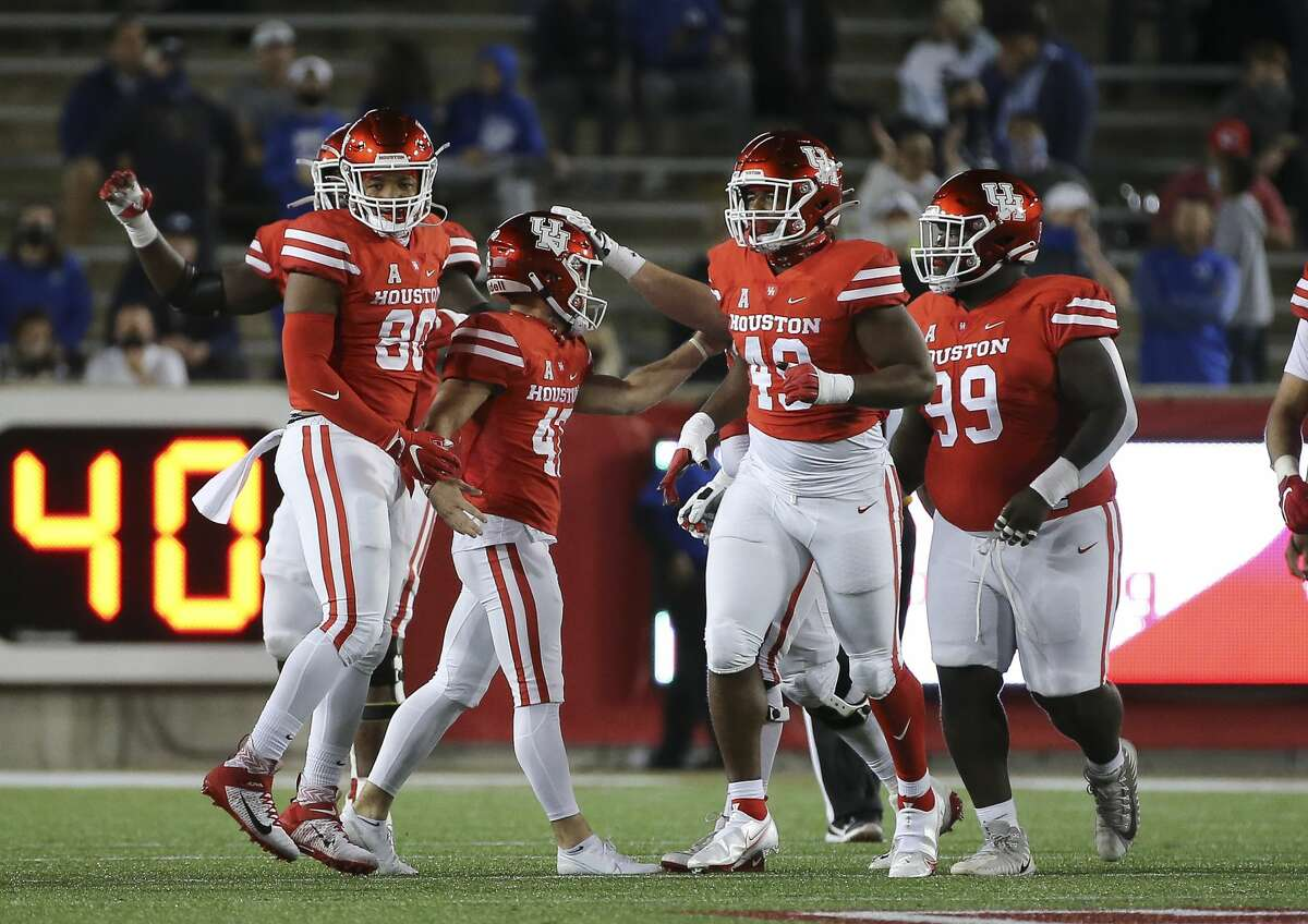 Houston Cougars players congratulate Houston Cougars place kicker Dalton Witherspoon (47) with his 49-yard field goal during the second quarter against the Brigham Young Cougars Friday, Oct. 16, 2020, at TDECU Stadium in Houston.