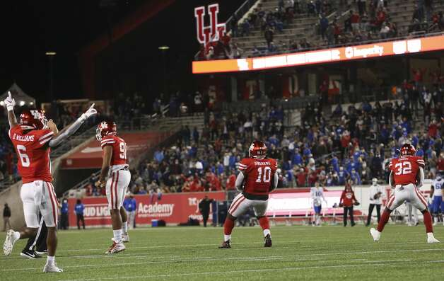 Houston Cougars players celebrate stopping Brigham Young Cougars from scoring a touchdown during the second quarter Friday, Oct. 16, 2020, at TDECU Stadium in Houston. Photo: Yi-Chin Lee/Staff Photographer / © 2020 Houston Chronicle
